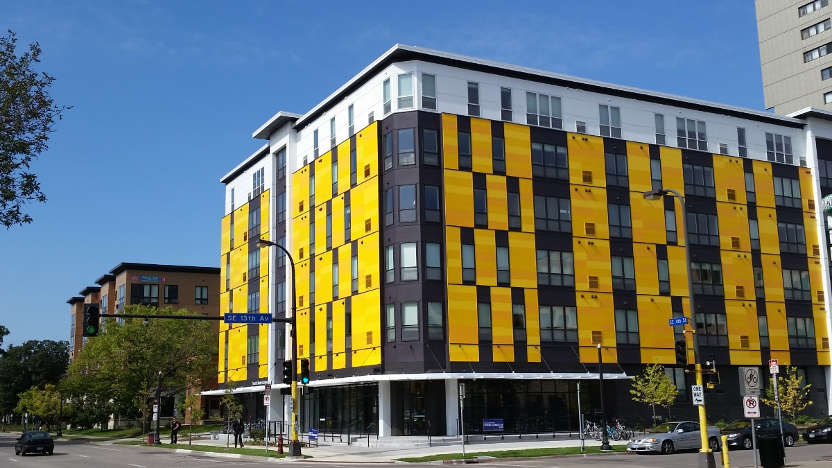 large modern yellow and white apartment building