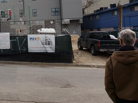 A photograph of ICC Austin's newest cooperative under construction in 2019 being viewed by a previous Director of ICC Austin, Jim Jones